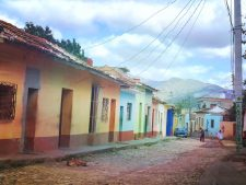Multi-coloured houses on a cobbled street in Trinidad