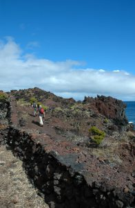 Walking on the black volcanic rock