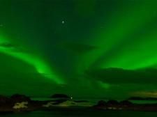 Trekking under an aurora borealis