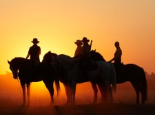 Riders at sunset