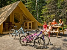 Bikes and tent of the park Pointe Taillon
