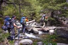 Crossing the river in the vegas de Los Troncos Vilches (Chile)