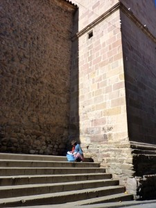 """Colonial Towns Extension– A """"cholita"""" on a church steps in Potosi"""