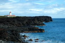 Ponta da Ilha lighthouse on black lava cliffs at the eastern tip of Pico